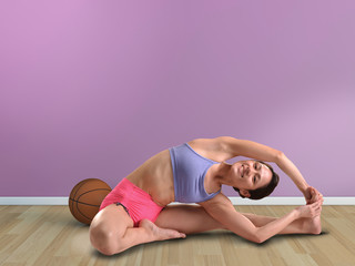Asian woman athlete stretching herself
