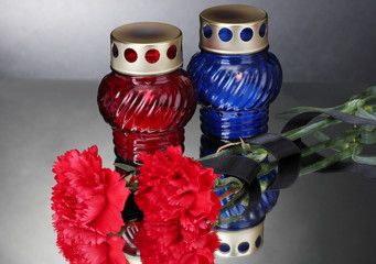 Memory lanterns with candles,  carnations and black ribbon