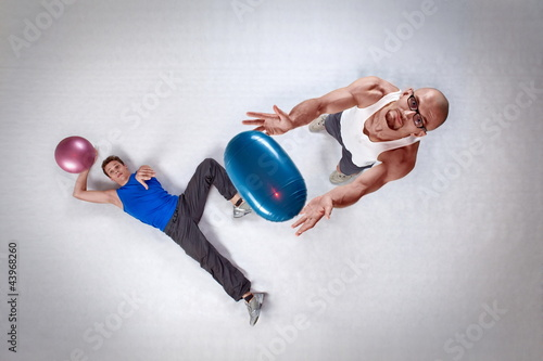 overhead view of two white men throwing balls