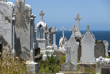 Gravestones in cemetery by the ocean
