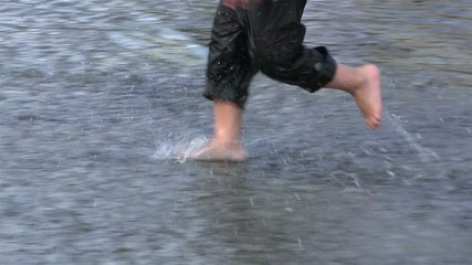 Children's feet running on water