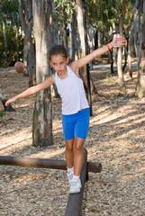 Girl walking on the balance beam