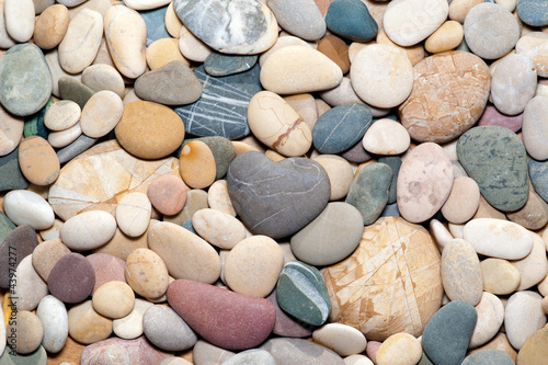 smooth stones with heart shaped stone