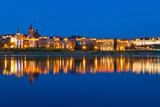 Grudziadz at night with reflection in Wisla river, Poland