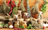Fototapety dried herbs, spices and and pepper, on wooden background