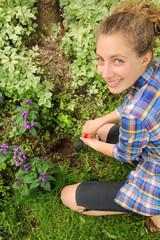 Teenager prepare soil