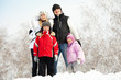Happy family in winter park
