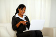 Afro-american businesswoman pointing to laptop