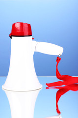 red and white megaphone on blue background