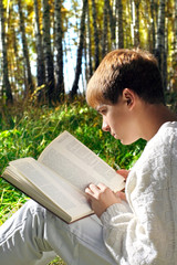 boy reading outdoor