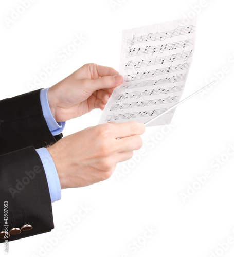 Music conductor hands with baton and notes isolated on white