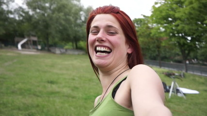 Young Woman spinning and laughing Handheld video