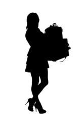 A silhouette of a full length portrait of a woman holding gifts