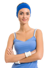 Young cheerful woman in fitness wear, isolated