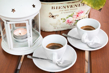Two cups of espresso coffee cafeteria garden closeup