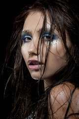 Young woman with creative make-up in mermaid style  Wet hair