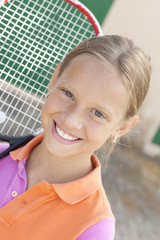 smiling girl with tennis racket