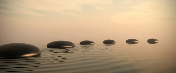 Zen path of stones on sunrise in widescreen