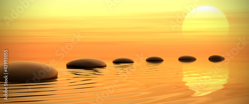 Fototapeta Zen path of stones on sunset in widescreen