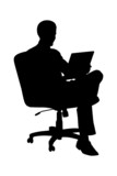 A silhouette of a businessman sitting in office chair and workin