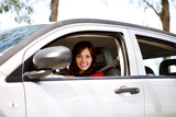 Smiling woman driving her modern car