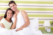 Romantic young couple in bed