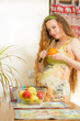Beautiful  woman with fresh fruit on the house kitchen