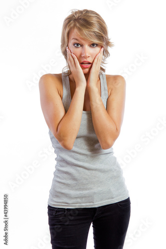 studio portrait of a beautiful blonde girl with  surprise