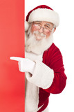 Santa pointing in red sing