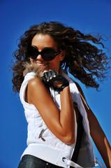 Girl in sunglasses smiling