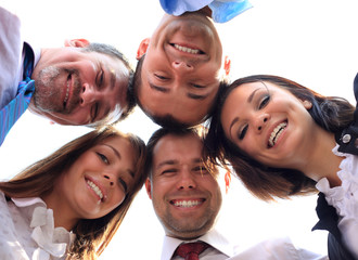 Low angle view of business people with their heads togethe