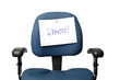 Office chair with a WANTED sign isolated on white background