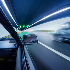 Fast cars in tunnel