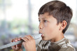 Boy playing recorder