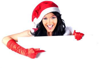 Miss Santa zeigt auf weiße Tafel
