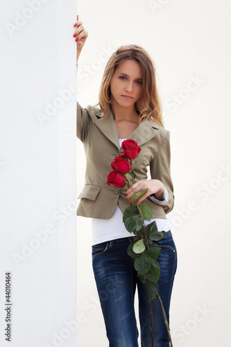 Sad young woman with a roses