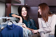 Friends do shopping at the boutique with great choice of clothes