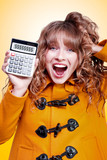 Excited winter woman holding savings calculator