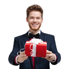 Man gives a present wrapped in red gift paper, isolated on white