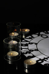 spiritualistic seance by candlelight close-up