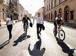 Businesspeople competing with bicycles and running in the city - 44013409