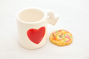 Cup of love and colorful cookie