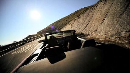 Luxury car road trip winding Pacific highway