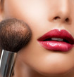 Make-up closeup. Cosmetic Powder Brush. Perfect Skin