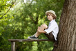 Boy sits on a wooden bench