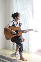woman playing folk guitar
