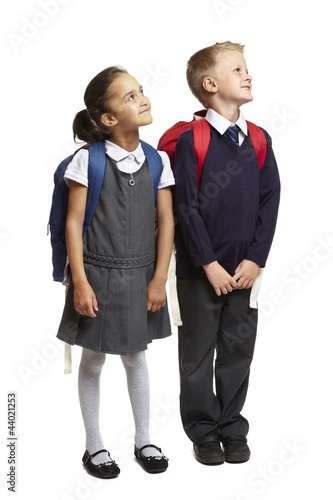 School boy and girl looking up