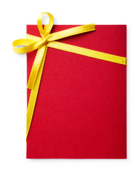 Blank red gift tag tied with a bow of gold satin ribbon