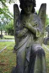 Kneeling angel statue, Brompton Cemetery, London