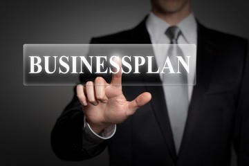 businessman pressing virtual button - businessplan